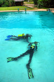 Two divers lie on bottom — Stock Photo