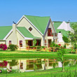 House, lake, lawn - Stock Photo