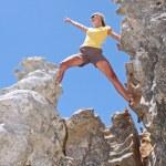 Girl on top of rock — Stock Photo