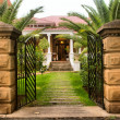 Entrance gate into beautiful old house — Stock Photo #22982190