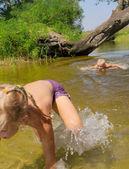 Children play in lake — Stock Photo