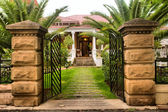 Entrance gate into beautiful old house — Stock Photo