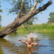 Happy children play in lake — Stock Photo
