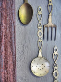 Vintage silverware on rustic wall — Stock Photo