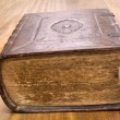 Old book on wooden table — Stock Photo