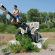 Kid plays on Soviet-times military monument — Stock Photo