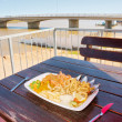 Lunch in outdoor restaurant next to Berg river - Stock Photo