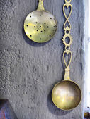 Vintage spoons on rustic wall — Stock Photo