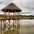 Thatch pavilion on lake in Karoo — Stock Photo