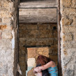 Depressed girl in abandoned house — Stock Photo