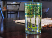 Vintage green glass on table — Stock Photo