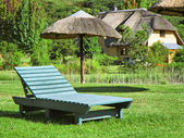 Green lounger on lawn — Stock Photo
