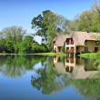 Traditional house next to lake — Stock Photo #25294371