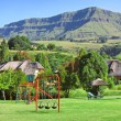 Children playground on estate in mountains - Stock Photo
