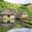 Traditional house on lake — Stock Photo