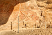 Wall in the Elands Bay cave with rock art — Foto Stock