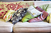 Stack of cushions on sofa — Stock Photo