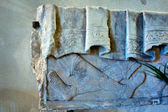 Fragment of ancient stone carving — Stock Photo