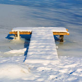 T-shaped wooden berth covered with snow — Stock Photo