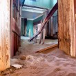 Corridor inside the abandoned house in sand — Stock Photo