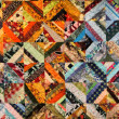 Fragment of warm-toned traditional carpet — Stock Photo #33217757