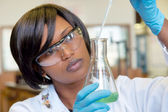 African female researcher with glass — Stock Photo