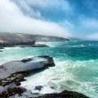 Awesome view at misty rocky beach — Stock Photo #46351491