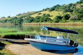 Blue boat on morning river — Foto Stock