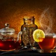 Glass teapot and cup on golden background — Stock Photo #20159925