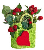 Decorative basket with raspberries — Stock Photo