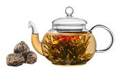 Exotic green tea with flowers in glass teapot isolated on white — Stock Photo