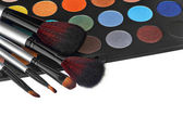 Eyeshadow kit for make-up over white background — Stock Photo