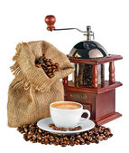 Coffee mill, canvas bag with coffee beans and a cup of black cof — Stock Photo