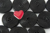 Gummy heart and spirals — Stock Photo