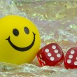 Smiley with pair of dice — Stock Photo #24416863