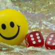 Smiley with pair of dice — Stock Photo