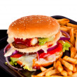Hamburger with fries isolated on black and white background — Stock Photo