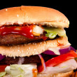 Hamburger with fries isolated on black background — 图库照片