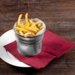 Delicious french fries on the table — 图库照片