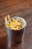 Delicious french fries on the table — Stock Photo