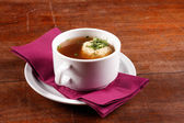 Delicious soup in white dish — Stok fotoğraf