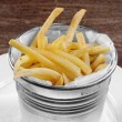 Delicious french fries on the table — Stock fotografie