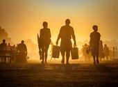Lots of people in the dust — Stock Photo