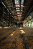 Dark industrial interior of a building — Стоковое фото