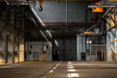 Dark industrial interior of a building — Stock Photo