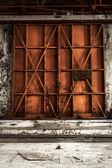 Closed Industrial door closeup photo — Стоковое фото