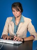Young woman at the helpdesk — Stock Photo