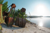 Large industrial machine on the shore — Stock Photo