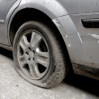 Stock Photo: Flat rear tire on car