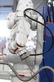 Industrial automated robot arm — Stock Photo